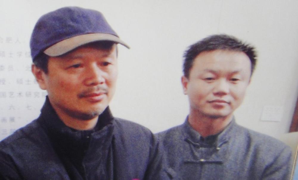 作者与田黎明教授合影